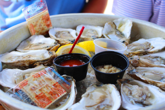 Eating buckets of fresh oysters.